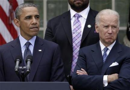 U.S. President Barack Obama speaks next to Vice President Joe Biden on commonsense measures to reduce gun violence, in Washington
